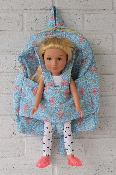 Cross Doll Carrier Backpack with Glitter Girl Doll in doll pocket